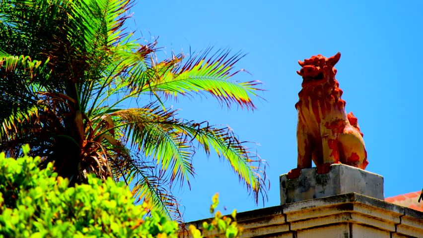 Shisa, a lion shaped statues placed as talisman against evil at entrances and on roofs.