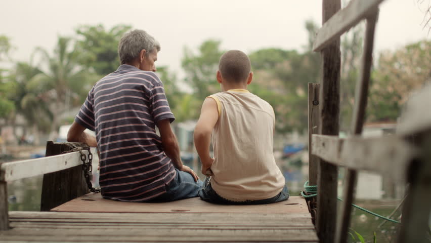 People and family recreation, senior man and boy fishing together on lake