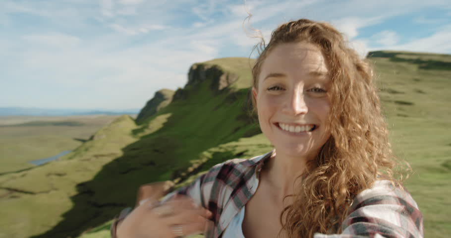 Beautiful woman having video chat using smartphone outdoors sharing travel adventure with friends bonding showing real emotional connection filming selfie video mobile phone enjoying Vacation Scotland | Shutterstock HD Video #25169090