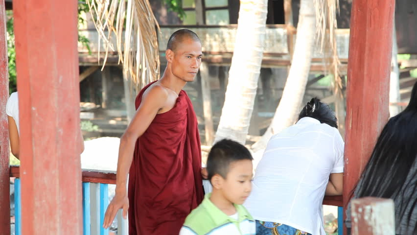 INLE LAKE, MYANMAR - APRIL 20: Visitors inside Nga Phe Kyaung Monastery  on April 20, 2012 on Inle lake, Myanmar. Inle lake isone of  the most popular place to visit in Myanmar.
