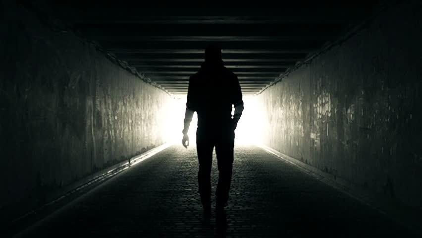 Slow Motion Video of Man walking in Tunnel to the Light | Shutterstock HD Video #25256111