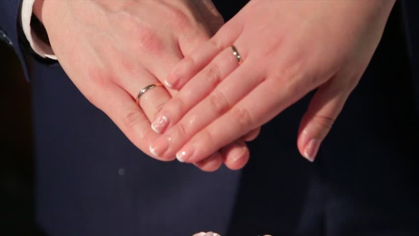 Newly Wed Coupleu0027s Hands With Wedding Rings. Bride And Groom With Wedding  Rings. Hands