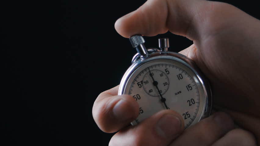 One person starting up a stopwatch at black background | Shutterstock HD Video #25430360
