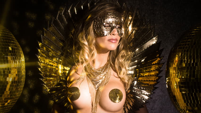 amazing sexy woman dances in a sparkling gold costume