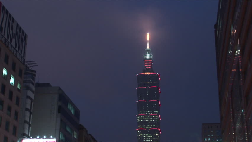 Taipei, Taiwan - CIRCA June, 2007: View of the top of the Taipei 101 tower lit up on a hazy night  | Shutterstock HD Video #2545370