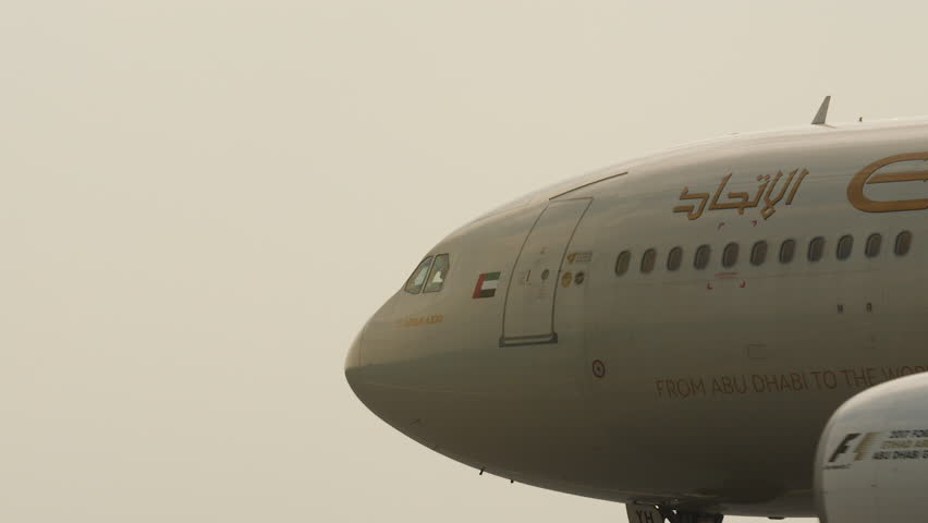 Amsterdam, March 2017. Giant Etihad Airbus airplane, close up nose, wings and engines as the plane turns and enters the runway.