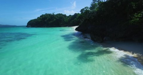 Aerial female model walking on tropical island beach