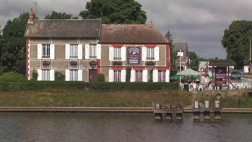 Famous Pegasus bridge Café Gondree in background overlooking the Caen Canal located in Benouville where France was liberated by the British 6th Airborne Division on D Day, June 1944. Normandy, France