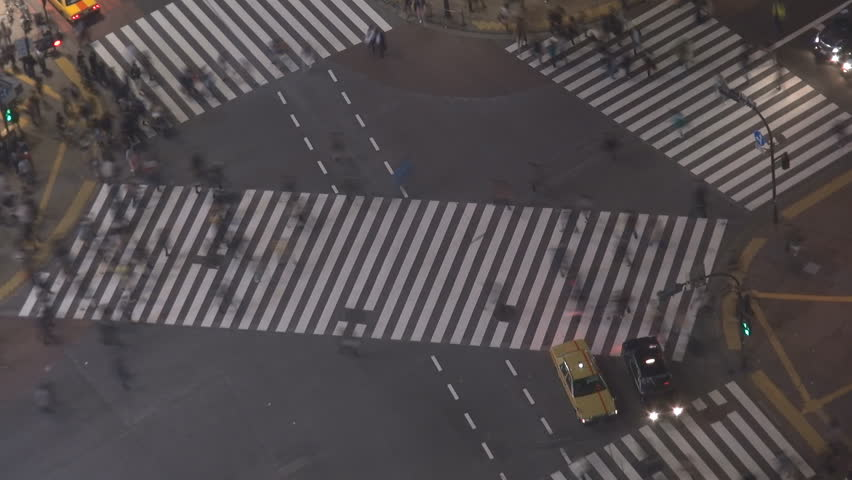 Timelapse of Shibuya pedestrian crossing by night, Tokyo, Japan