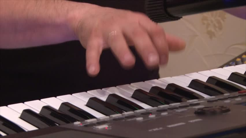 Hands playing a synthesizer | Shutterstock HD Video #25526210