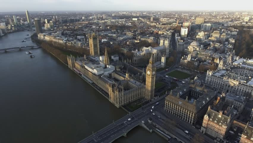 Dramatic Aerial Flight Over London Big Ben aka Houses of Parliament in Westminster feat Local Traffic and River Thames 4K