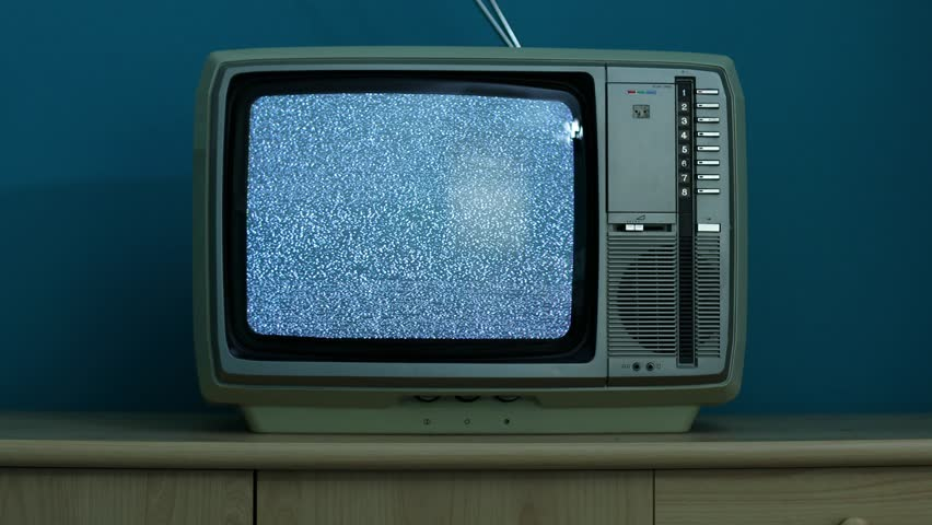 Static noise on a vintage TV set in a dim room | Shutterstock HD Video #25545830