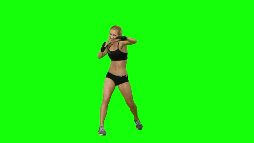 Girl boxer sends frequent blows to the enemy. Green screen #25547240