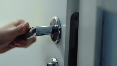 Close up shot of door opening by handle. Somebody looking inside.