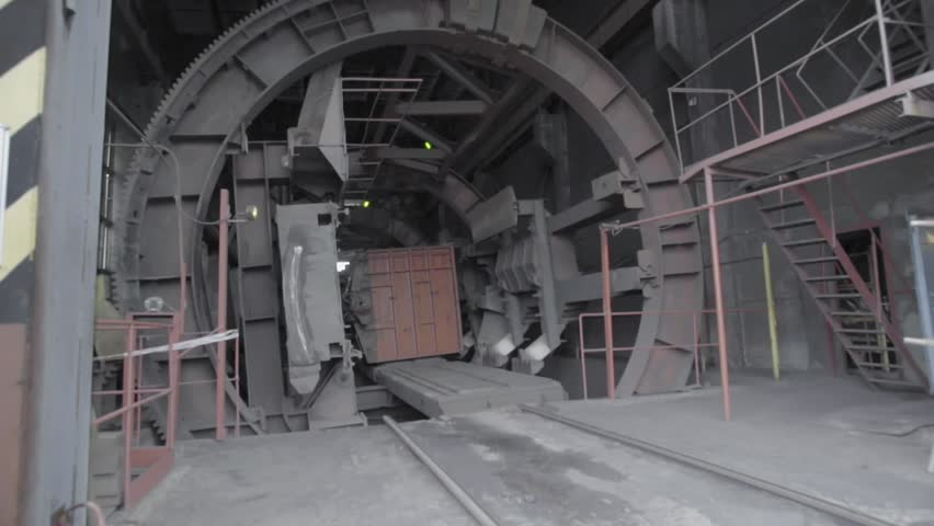 Rotary car dumper unloading coal