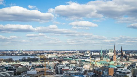 HAMBURG, GERMANY – April 4, 2017: View of hamburg with fluffy clouds by day timelapse Hamburg city with small clouds  and blue sky by day.