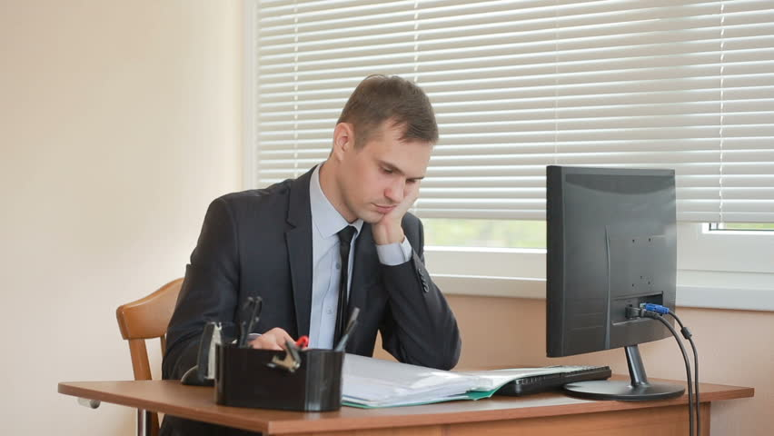 Manager At The Office Sits Table Tired Of Work Hd Stock Footage Clip
