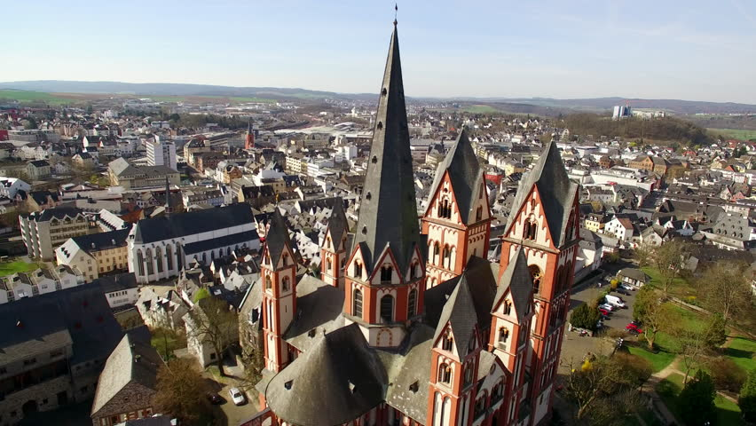 The Dom of Limburg. The camera circles aroung the tower of the famous cathedral in Limburg.