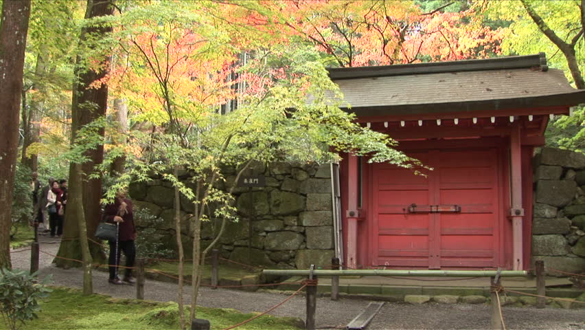 Kyoto, Japan - CIRCA November, 2006: A classically designed Japanese Buddhist temple in a forest during the day
