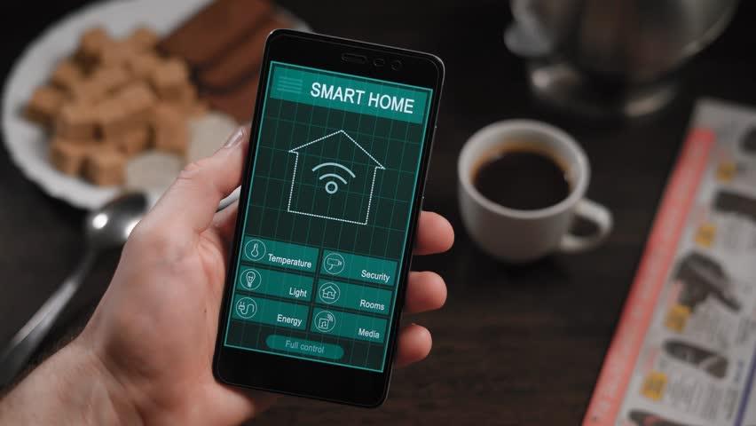 Smart Home Man Using Smart Home App On A Smart Phone