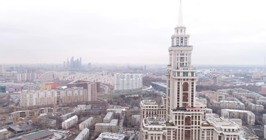 """MOSCOW, RUSSIA - April 03, 2017: Residential complex """"Triumph Palace"""". Flight over the tower with a spire. 