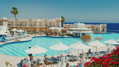 Sharm el Sheikh, Egypt, March, 2017: The hotel is a resort with a large swimming pool, a bar and sun umbrellas. Tourists relax and sunbathe