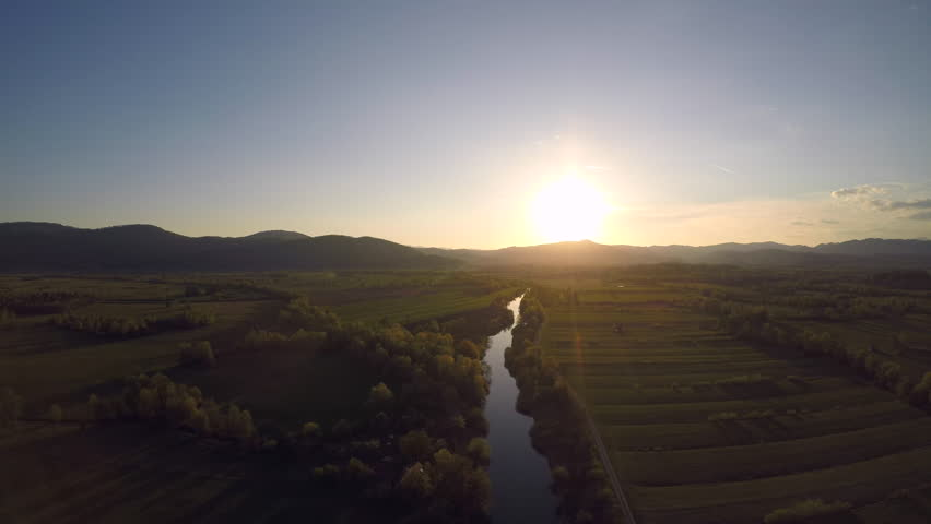 Aerial flight over a wetland at sunset