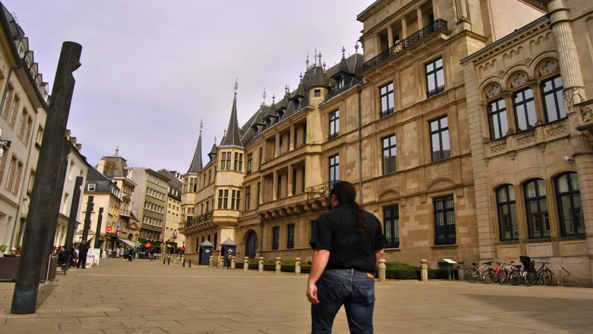 Luxembourg town centre timelapse Palace Palais Grand Ducal residence Historical city hall People rushing and exploring Crowd of busy people City street Tourists pedestrians passing Holiday place 2160p