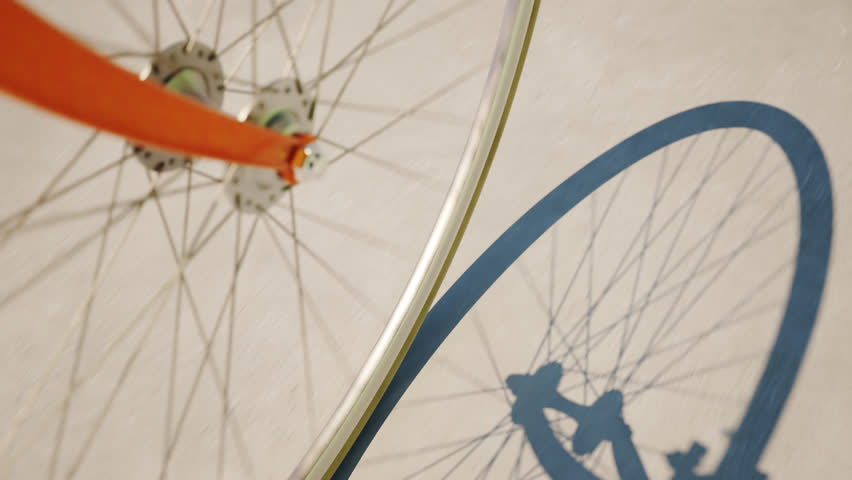 High angle view of bicycle wheel on the concrete road
