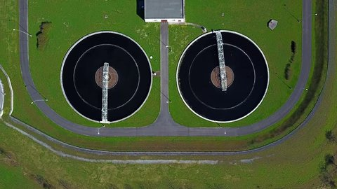 Camera flight over sewage treatment plant. Aerial view of industrial water treatment for big city.