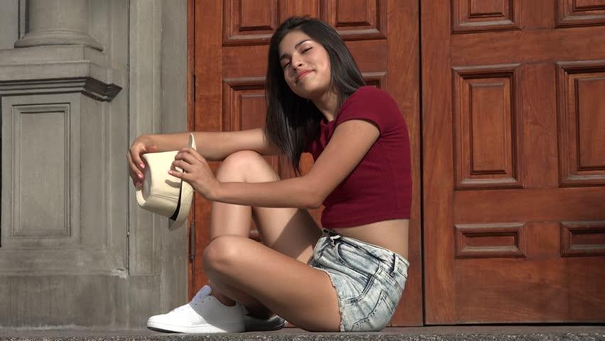 Happy Teen Girl Sitting   Shutterstock HD Video #25832093