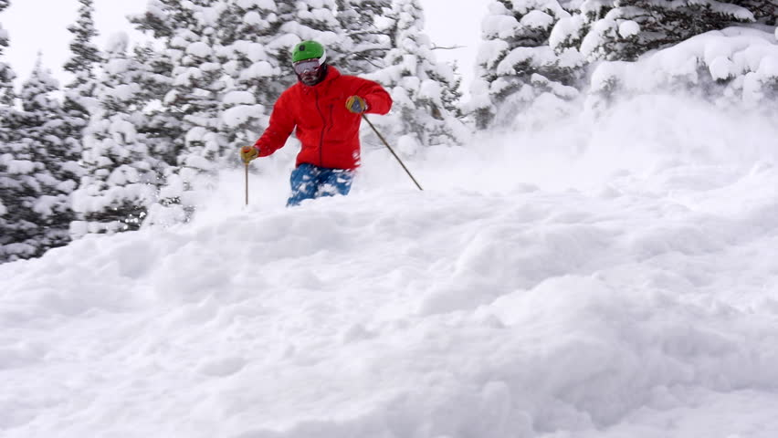 Expert male ski deep powder snow in Park City, Deer Valley, Utah.