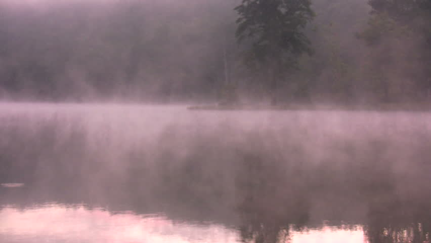 pre-dawn fog rises on Sherando Lake, Virginia - tight angle 1
