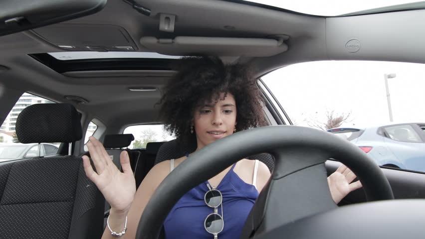Woman driving an autonomous car