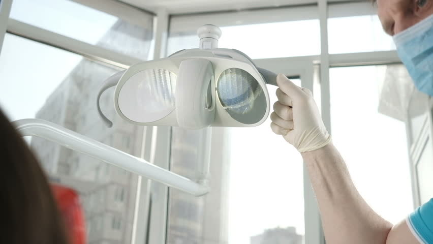 Dentist turns on the light. Medical lamp in the dentist's office. Medical equipment. Preparing for treatment the patient. | Shutterstock HD Video #25951700