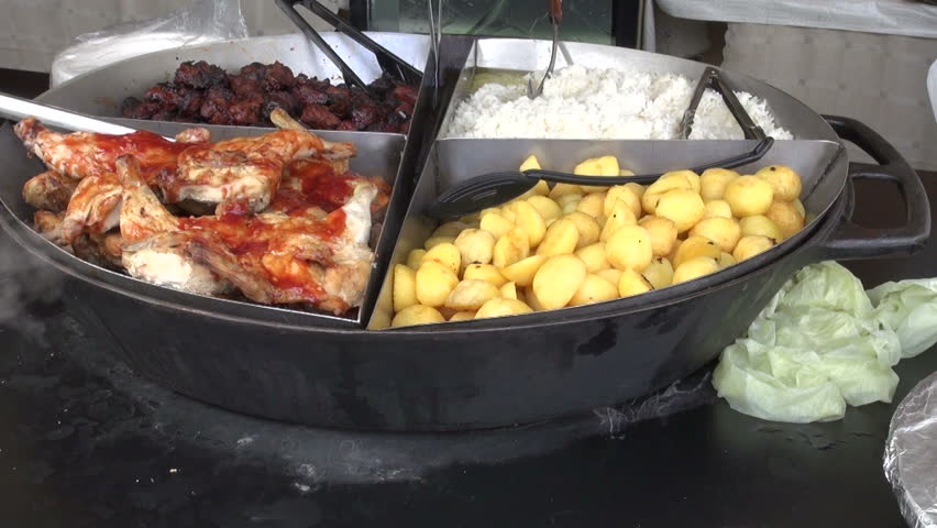 Various meat and vegetable dish in street food fair   Shutterstock HD Video #25957625