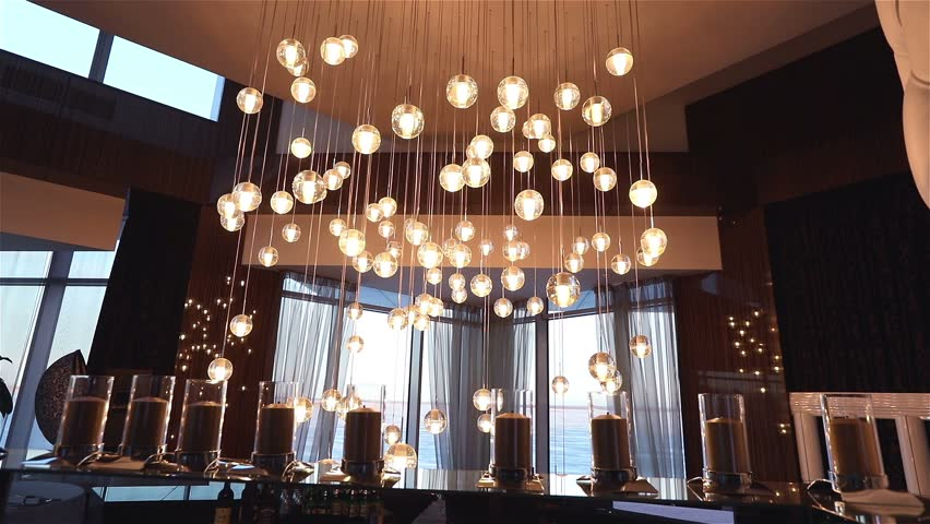 Hall of a hotel or restaurant, chandelier in the lobby, Chandelier hangs from the ceiling, creative, modern, interior, hotel or restaurant interior, Columns, white skin, motions, view, window