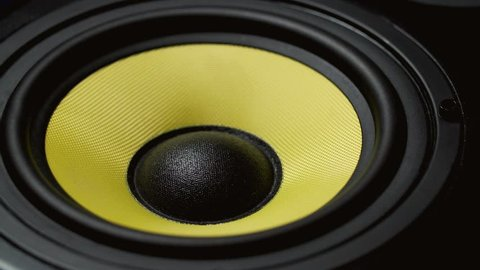 Close up at moving sub-woofer. Speaker part. Black and yellow colors of membrane. Concept of musical instrument. 4k video shot.