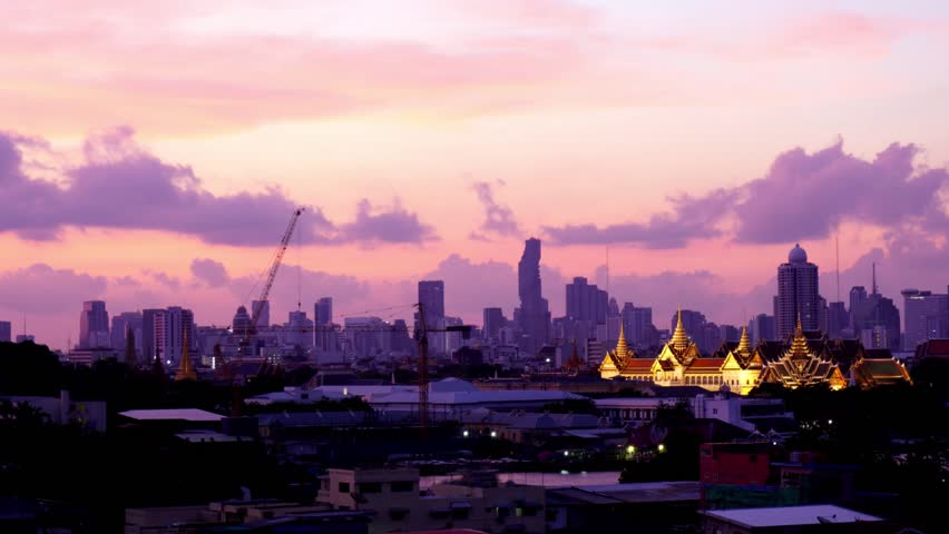 Time lapse landmark of Bangkok city view, Grand palace and Wat phra keaw at sunrise bangkok, Thailand