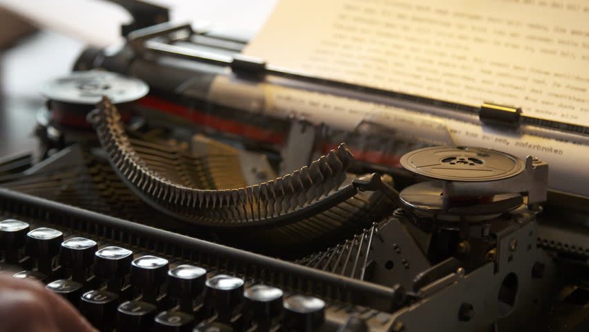Typing on a piece of paper on a typewriter, close up.