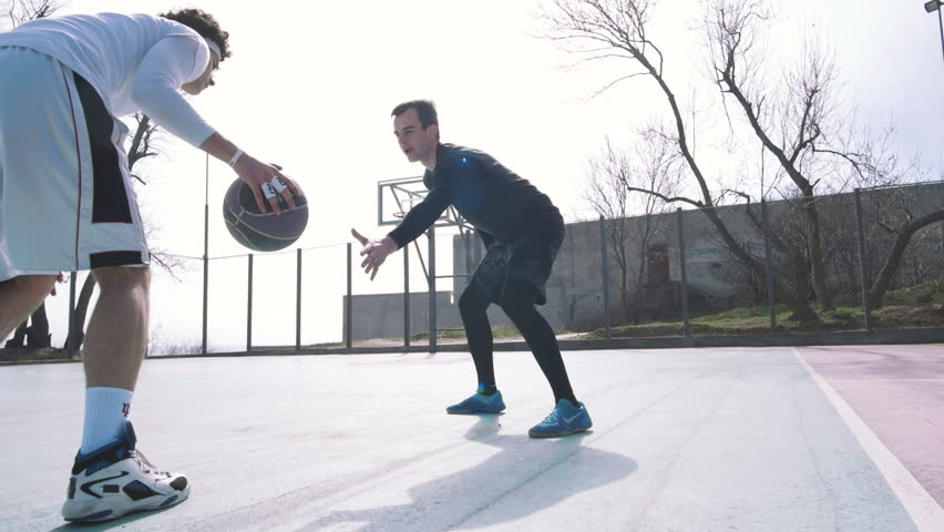 Two basketball player playing basketball outdoors, slow motion #25999040