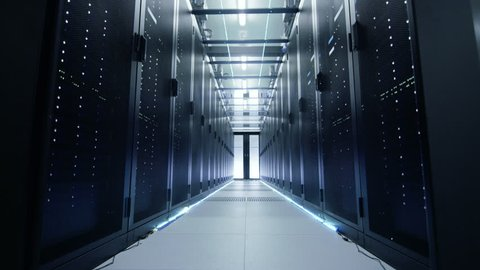 Camera Moves Through Opening Doors Into Data Center. Rack Servers are Ultra Modern and Lit by LED Lights. Shot on RED EPIC-W 8K Helium Cinema Camera.