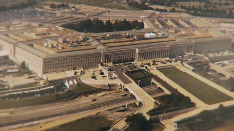Aerial establishing shot of the pentagon with a small amount of traffic in front of the building.