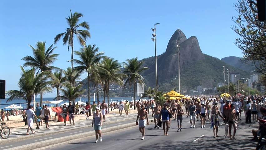 RIO DE JANEIRO, BRAZIL - CIRCA 2010: Crowded Beach Sidewalk In Rio De Janeiro, Brazil 8