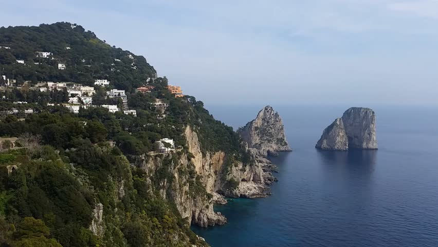 Capri (Naples), Campania area, Italy. Aerial footage of the beautiful and well known Faraglioni. The three spurs of rock which rise up out of the sea in a wonderful day.