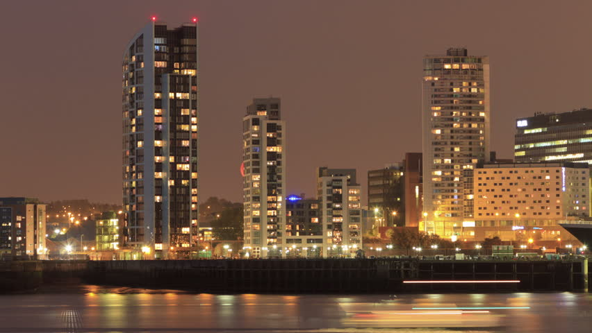 Time lapse of full Moon rising over apartment blocks on the Liverpool waterfront