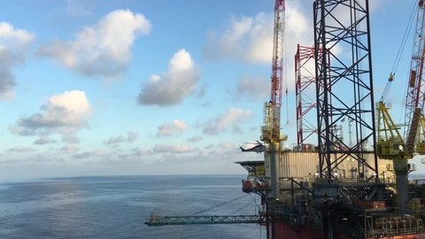 Helicopter landing on jacket oil rig helideck, Helicopter transfer crews or passenger to work in offshore oil and gas industry, air transportation for support passenger.