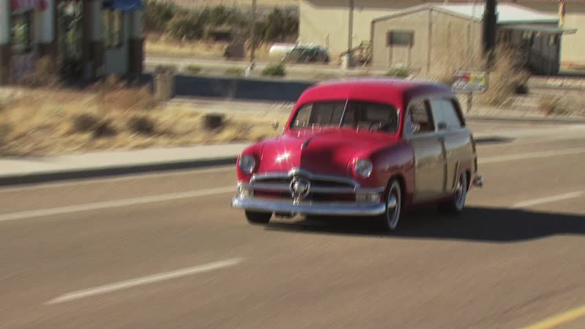 SMALL TOWN USA - CIRCA 2010: Classic Station Wagon Red With Wood Side Panels 3