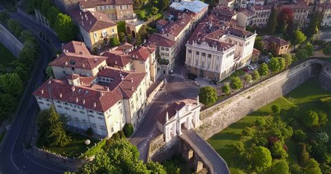 4K Drone aerial view of Bergamo - Old city (Città Alta). One of the beautiful city in Italy. Landscape on the old gate named Porta San Giacomo and historical buildings during a wonderful blu day