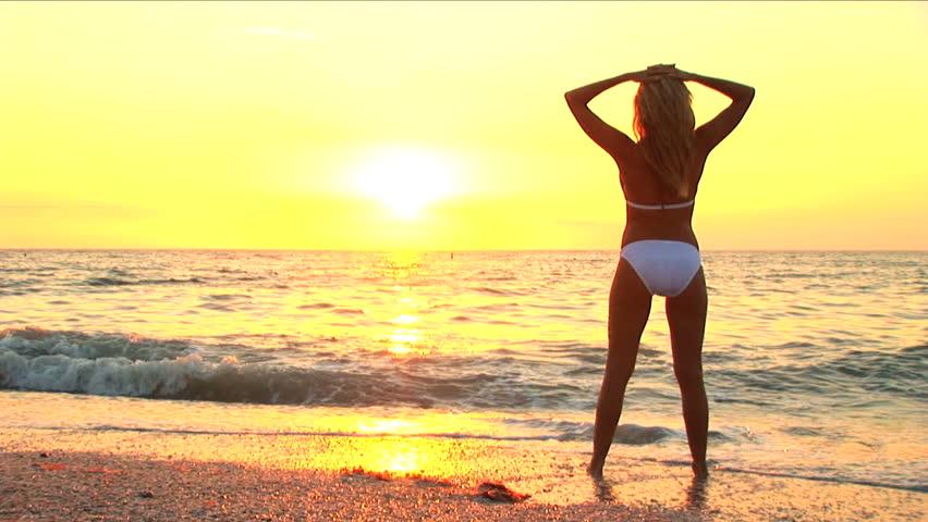 Beautiful blonde girl enjoys the beach lifestyle | Shutterstock HD Video #261196
